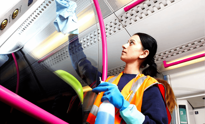 employee cleaning the plane